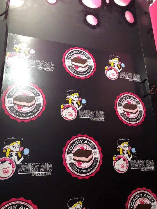 """The """"sexy cow"""" logo on a wall of the Dairy Air ice cream shop, which has closed. December 10, 2018."""