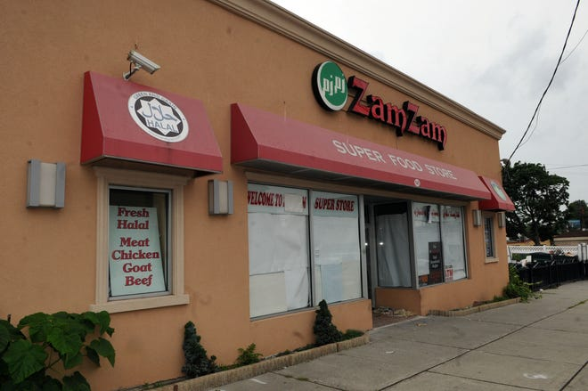 The Zam Zam market as it looked just after the fatal shooting of Jose Rodriguez. The victim was shot on the front sidewalk.