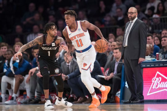 New York Knicks head coach David Fizdale, right, watches as guard Frank Ntilikina (11) drives against Brooklyn Nets guard D'Angelo Russell (1) during the second half of an NBA basketball game, Saturday, Dec. 8, 2018, at Madison Square Garden in New York. The Nets won 104-112.