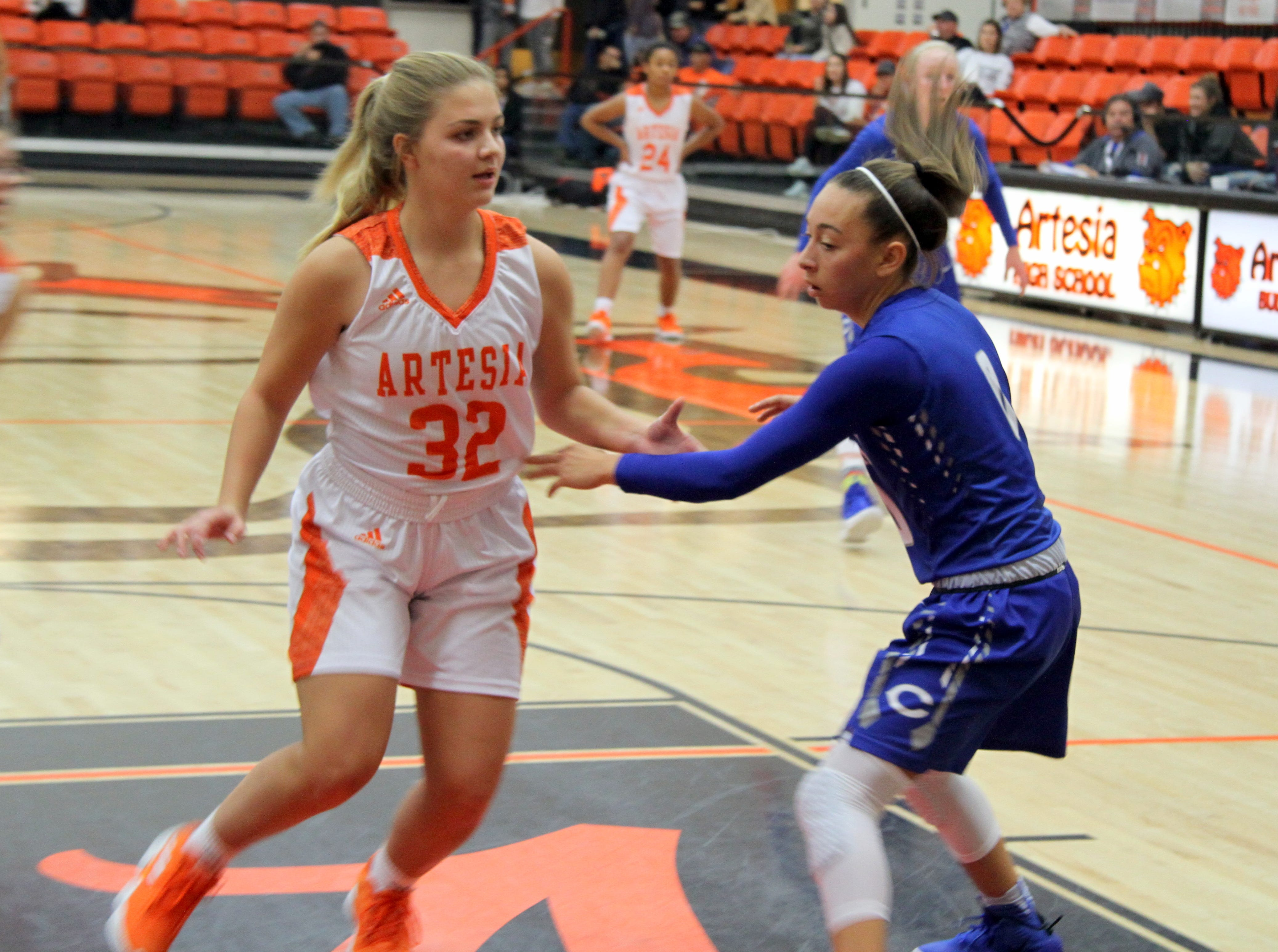 Talyn Lopez (32) tries to get open for a pass while Bailee Molina guards her during Saturday's third-place game in Artesia.