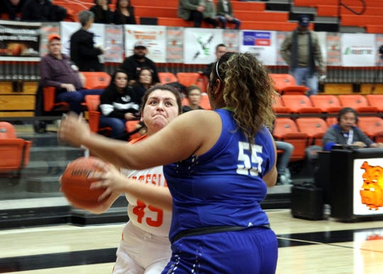 Artesia's Veronica Soto (45) drives against Carlsbad's Kaliyah Montoya (55) during Saturday's third-place game in Artesia.