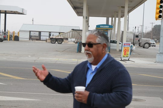Eddy County Public Works Director Ray Romero speaks during a ribbon cutting Monday morning celebrating the reopening of Standpipe Road.