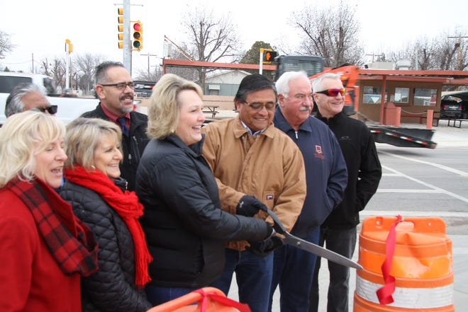 (Front row from left)-Debra Hicks, Stella Davis, Susan Crockett, Eddie Rodriguez, Dave Sepich and Rick Rudometkin cut the ribbon during a dedication ceremony for Standpipe Road. After months of construction, the road was reopened before Thanksgiving.