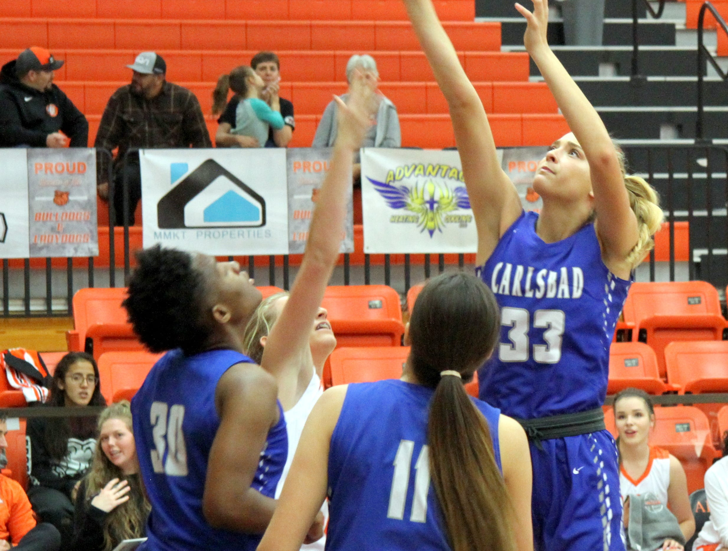 Jordan Boatwright (33) shoots over an Artesia defender during Saturday's third-place game in Artesia.