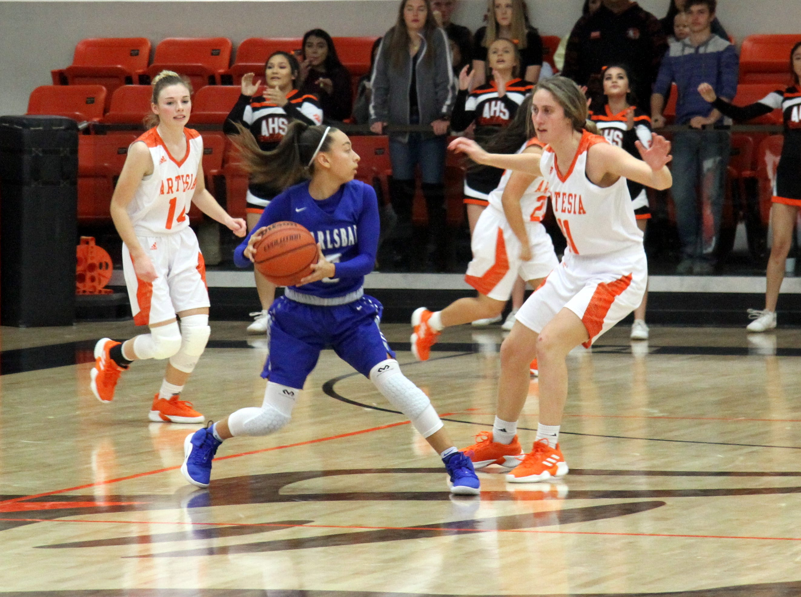 Carlsbad's Bailee Molina looks to pass while Artesia's Makinli Taylor defends during Saturday's third-place game in Artesia.