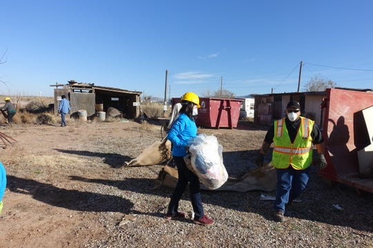 Many of the volunteers that helped with the recent clean-up were executives with WINNResidential, who were at Holloman Air Force Base for a conference.