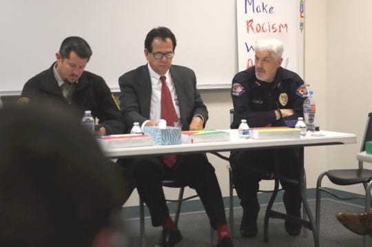 Sheriff-elect Shane Ferrari, County Commissioner Jack Fortner and Farmington Police Chief Steve Hebbe participate in an immigration panel, Monday at Rocinante High School.