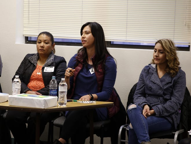 Somos Un Pueblo Unido community organizer Elsa Lopez, center, talks about immigration, Monday, Dec. 10, 2018, at Rocinante High School in Farmington.