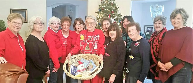 Members of the Eta chapter of Alpha Delta Kappa gathered reading and activity books to present to the first baby born at the Lincoln County Medical Center in 2019.  From left are Dottie MacVeigh, Eva Clarke, Martha Bond, Darla Lathan, Connie Forrest, Roxie Moore, Ruby Dulin, Alicia Annala, Cherri Goad, Joyce Davies, Beth Nosker and Donna Sisneros.