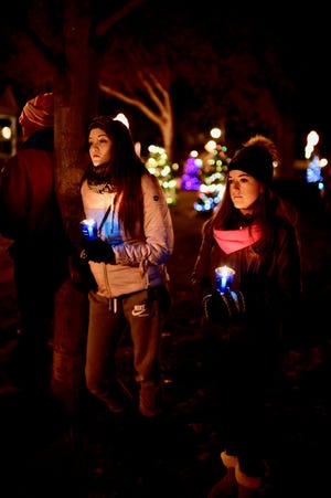 Sisters Rachel and Brianna Blackwood remember sister Amy Louise at the candle-lighting Sunday in Plymouth.
