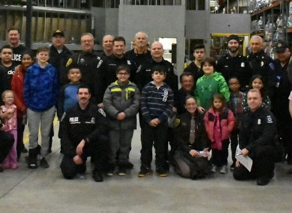 """Thirty children were chosen to """"Shop With a Hero"""" in the annual event at the Wixom Meijer store."""