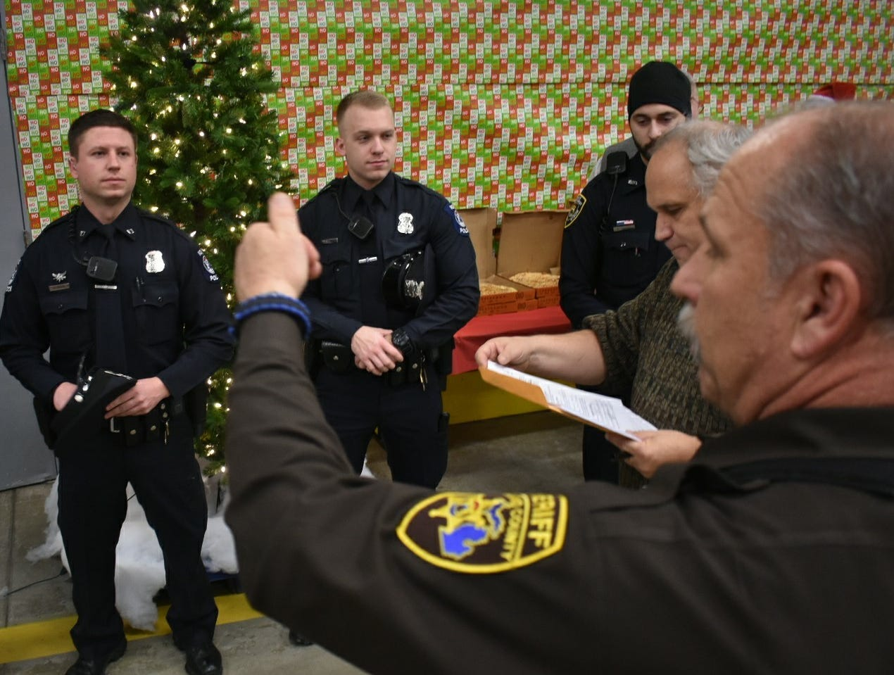 Local officers took part in the annual Shop With a Hero event at the Wixom Meijer.