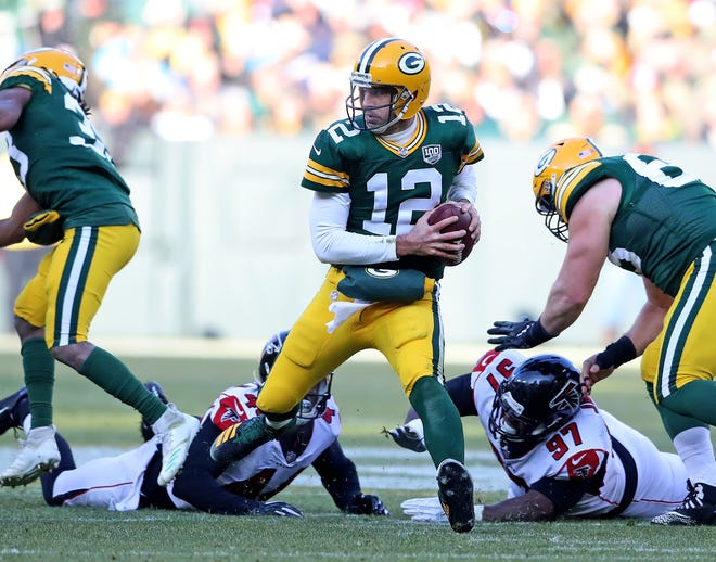 Green Bay Packers quarterback Aaron Rodgers (12) looks for room as the pocket collapses against the Atlanta Falcons Sunday, December 9, 2018 at Lambeau Field in Green Bay, Wis. Jim Matthews/USA TODAY NETWORK-Wis