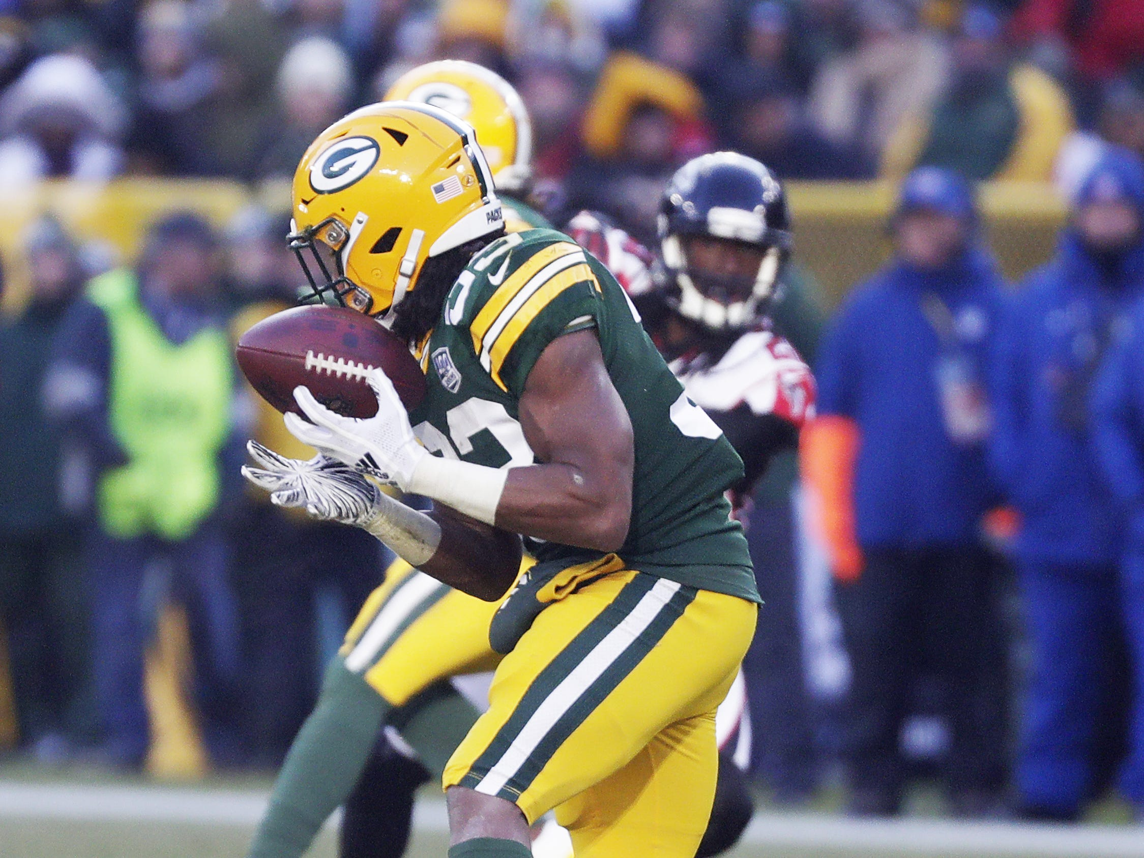 Green Bay Packers running back Aaron Jones (33) makes a catch in the third quarter against the Atlanta Falcons at Lambeau Field on Sunday, December 9, 2018 in Green Bay, Wis. Adam Wesley/USA TODAY NETWORK-Wis