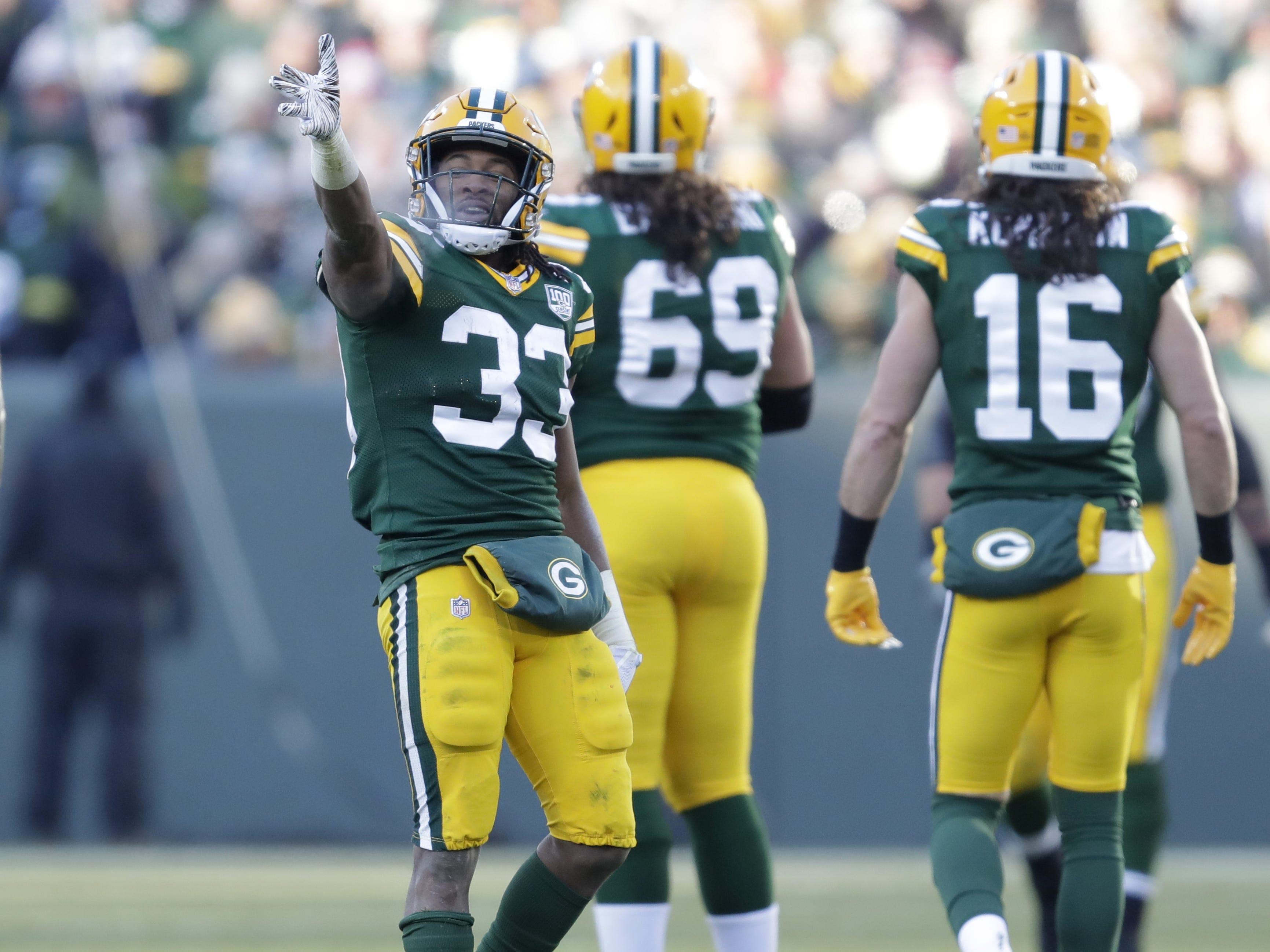 Green Bay Packers running back Aaron Jones (33) signals for a first down against the Atlanta Falcons Sunday, December 9, 2018, at Lambeau Field in Green Bay, Wis.  Dan Powers/USA TODAY NETWORK-Wisconsin