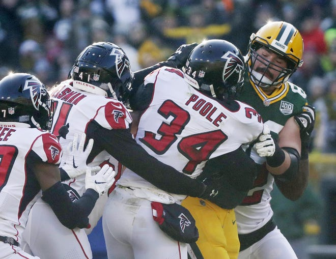 Green Bay Packers offensive guard Lucas Patrick (62) confronts Atlanta Falcons cornerback Brian Poole (34) after pool hit quarterback Aaron Rodgers (12) in the second quarter at Lambeau Field on Sunday, December 9, 2018 in Green Bay, Wis. Adam Wesley/USA TODAY NETWORK-Wis