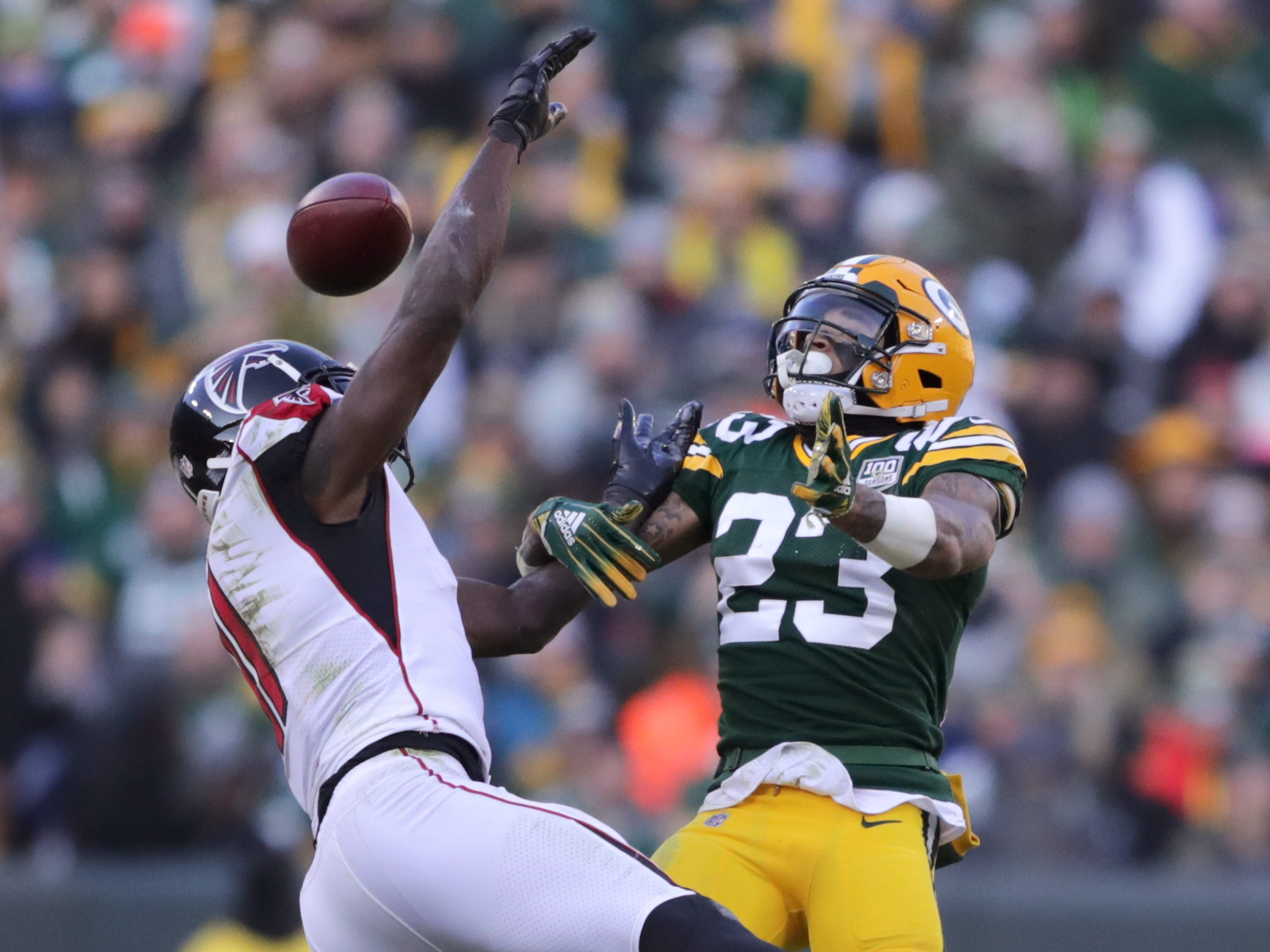 Green Bay Packers cornerback Jaire Alexander breaks up a pass intended for Atlanta Falcons wide receiver Julio Jones during their football game on Sunday, December 9, 2018, at Lambeau Field in Green Bay, Wis. Wm. Glasheen/USA TODAY NETWORK-Wisconsin.
