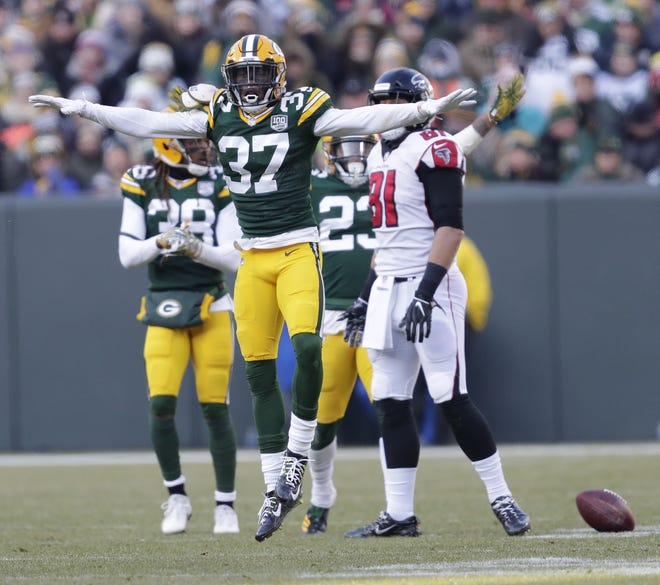 Green Bay Packers cornerback Josh Jackson (37) celebrates breaking up a pass intended for Atlanta Falcons tight end Austin Hooper (81) Sunday, December 9, 2018, at Lambeau Field in Green Bay, Wis.  Dan Powers/USA TODAY NETWORK-Wisconsin