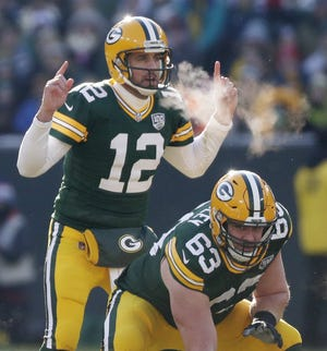 Packers quarterback Aaron Rodgers (12) directs the offense before the snap Dec. 9 against the Atlanta Falcons at Lambeau Field in Green Bay.