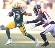 Packers running back Aaron Jones (33) is a good zone runner, but he has sustained three MCL tears in his two NFL seasons.