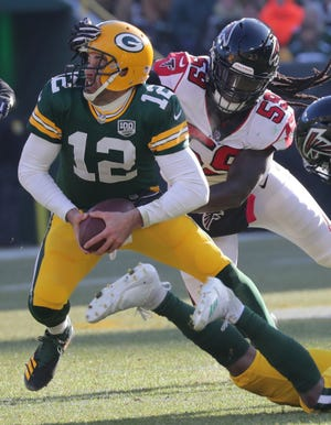 Green Bay Packers quarterback Aaron Rodgers (12) tries to evade a sack by Atlanta Falcons outside linebacker De'Vondre Campbell (59) during the second quarter of their game Sunday, December 9, 2018 at Lambeau Field in Green Bay, Wis.  MARK HOFFMAN/MILWAUKEE JOURNAL SENTINEL