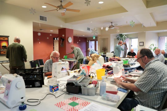 The Sewing with Purpose group work in a room at Desert AIDS Project on Monday, Dec. 10, 2018, in Palm Springs, Calif.