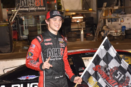 Chase Purdy celebrates in Victory Lane after his win Sunday in the Allen Turner Snowflake 100.