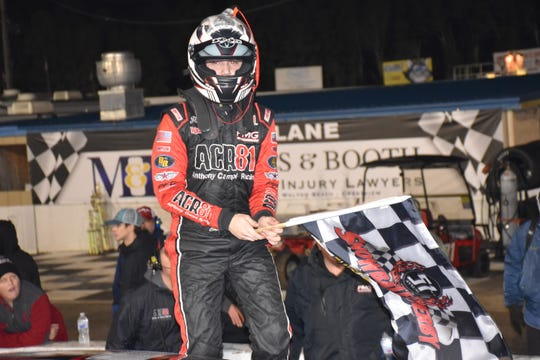 Chase Purdy, 19, a Meridian, Miss. native, celebrates after emerging from his race car late Sunday, following his win in the Allen Turner Snowflake 100 at Five Flags Speedway.