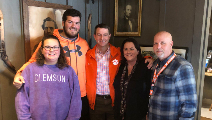 Clemson head coach Dabo Swinney  visits Pensacola High senior Hunter Rayburn (center left) and his family on Dec. 6 , 2018. Rayburn is set to enroll at Clemson in January 2019.