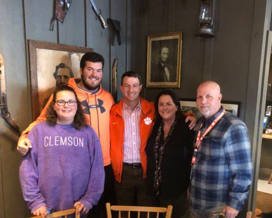 Clemson head coach Dabo Swinney  visits Pensacola High senior Hunter Rayburn (center left) and his family on Dec. 6 , 2018. Rayburn is set to enroll at Clemson in January 2019.