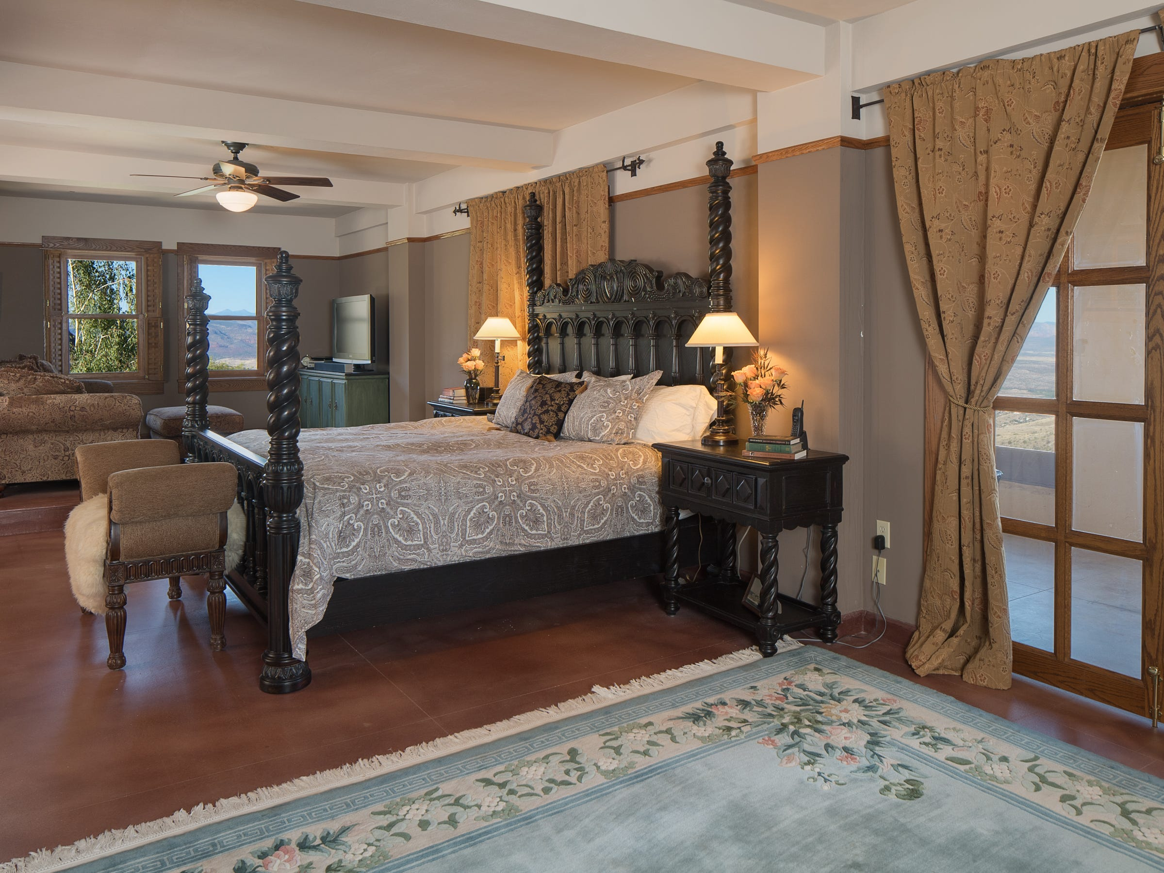 The master bedroom is seen in the 100-year-old former Little Daisy Hotel in Jerome, which was later turned into a single-family home and is now on the market.