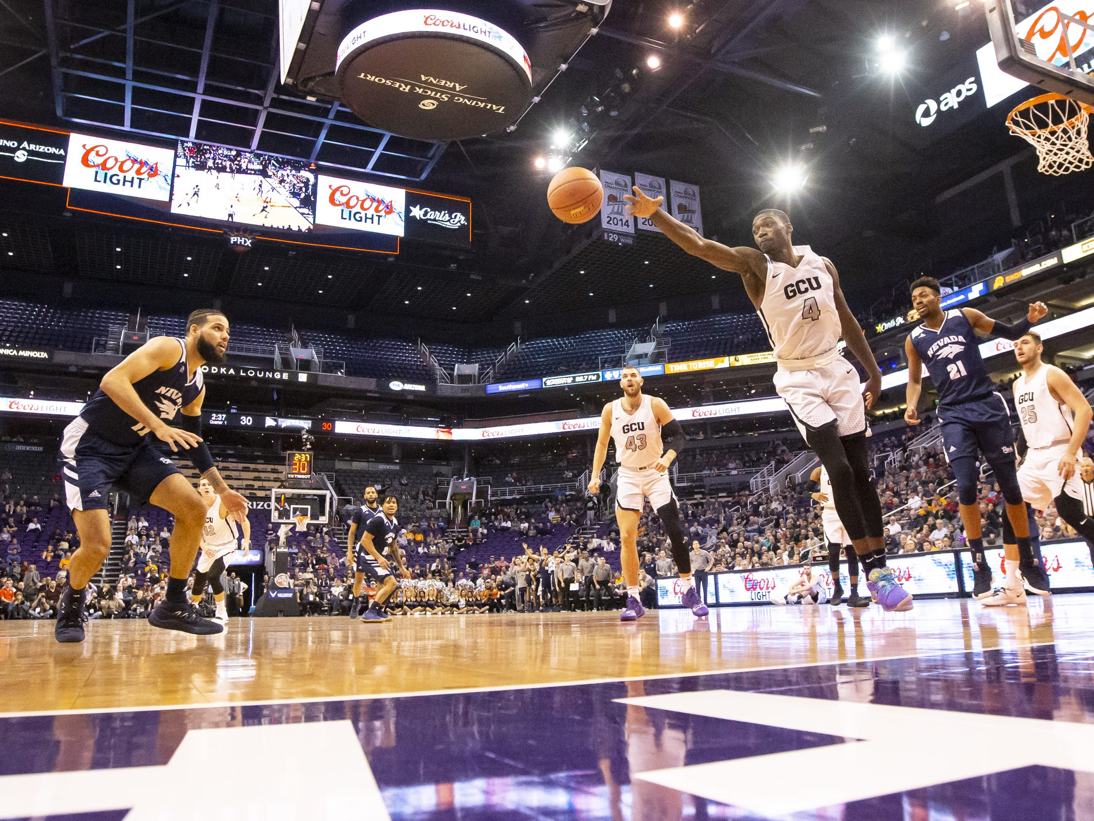 Forward Oscar Frayer (4) of the Grand Canyon Antelopes reaches for a wild pass against Nevada Wolf Pack during the 2018 Jerry Colangelo Classic at Talking Stick Resort Arena on Sunday, December 9, 2018 in Phoenix, Arizona.
