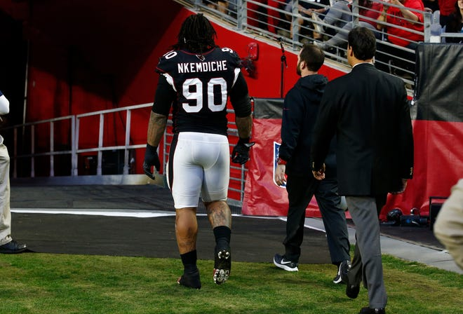 Arizona Cardinals defensive tackle Robert Nkemdiche (90) leaves the field after an injury against the Detroit Lions on Sunday, Dec. 9, 2018, in Glendale, Ariz.
