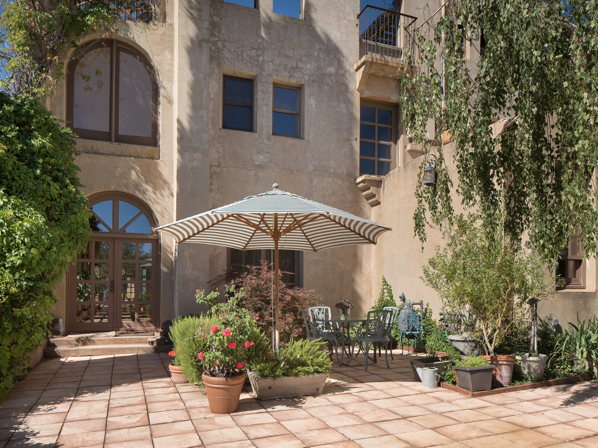 The patio off the dining kitchen is seen in the 100-year-old former Little Daisy Hotel in Jerome, which was later turned into a single-family home and is now on the market.
