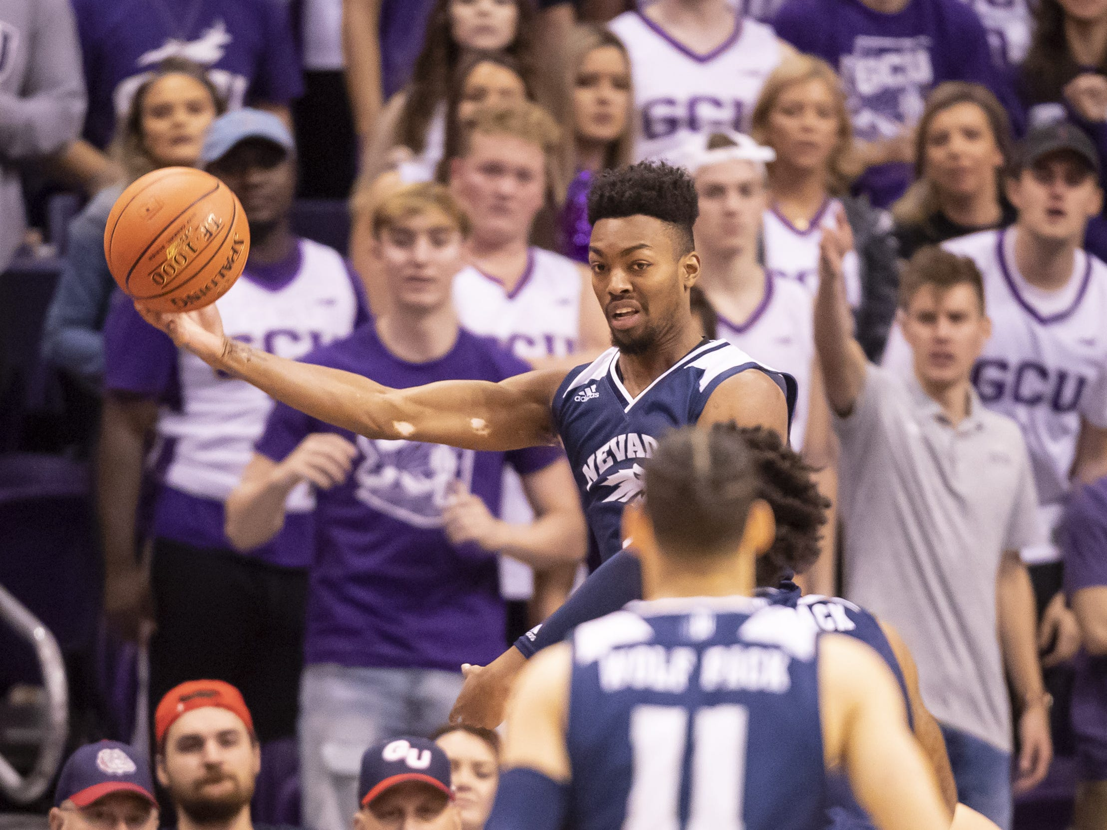 Forward Jordan Brown (21) of Nevada Wolf Pack saves the ball from going out of bounds against the Grand Canyon Antelopes during the 2018 Jerry Colangelo Classic at Talking Stick Resort Arena on Sunday, December 9, 2018 in Phoenix, Arizona.