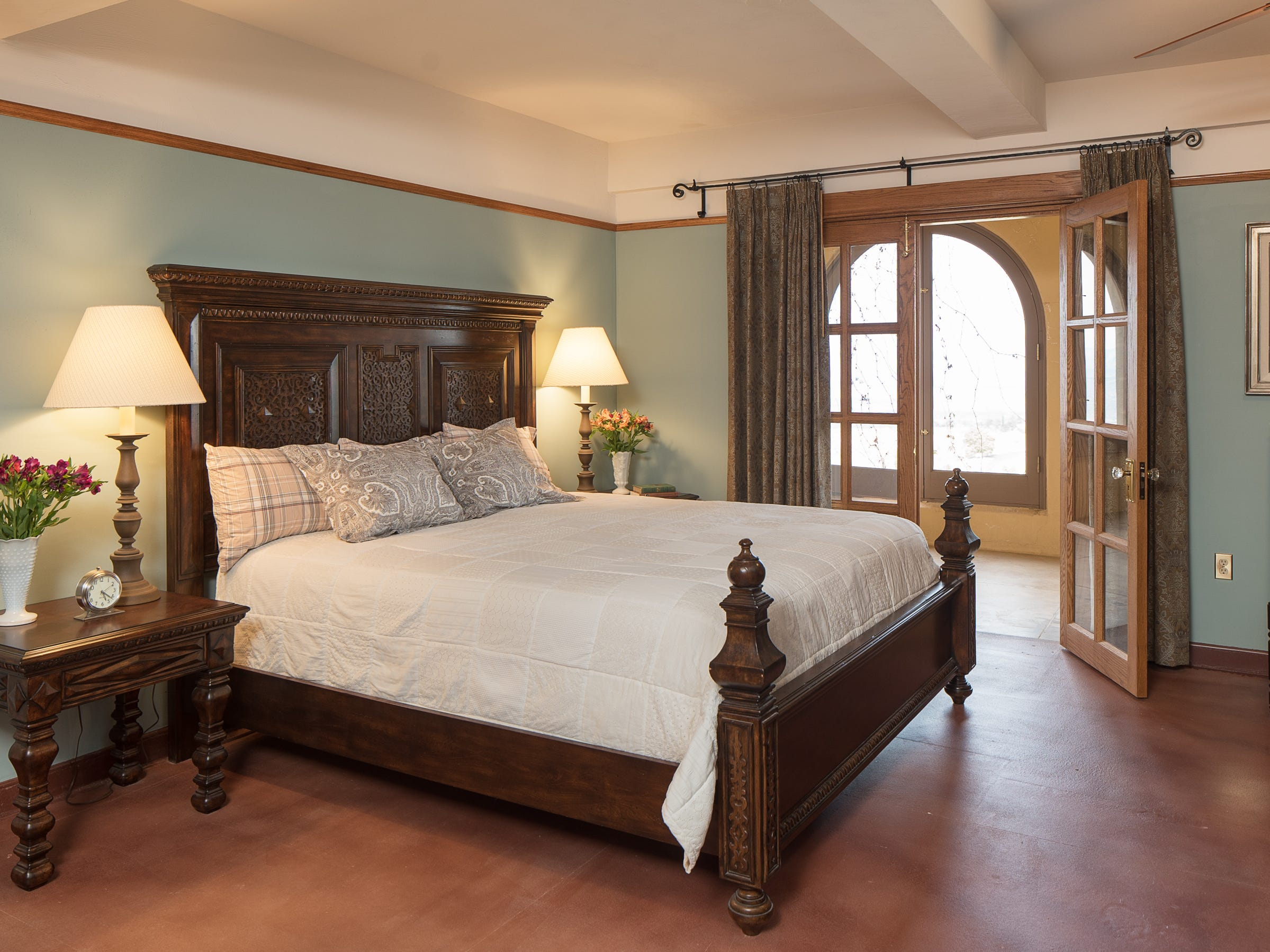 The King bedroom No. 1 is seen at the 100-year-old former Little Daisy Hotel in Jerome, which was later turned into a single-family home and is now on the market.