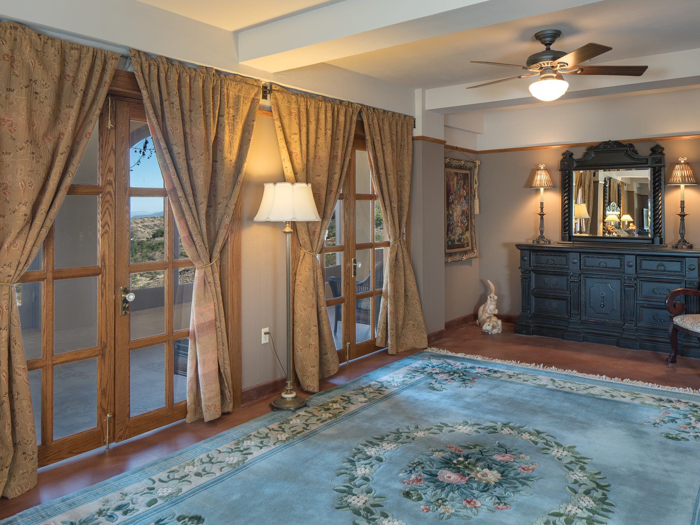 French doors in the master bedroom are seen in the 100-year-old former Little Daisy Hotel in Jerome, which was later turned into a single-family home and is now on the market.
