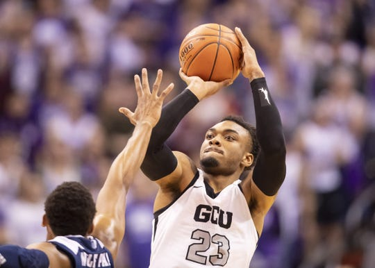 Guard Carlos Johnson (23) of the Grand Canyon Antelopes shoots against Nevada Wolf Pack during the 2018 Jerry Colangelo Classic at Talking Stick Resort Arena on Sunday, December 9, 2018 in Phoenix, Arizona.