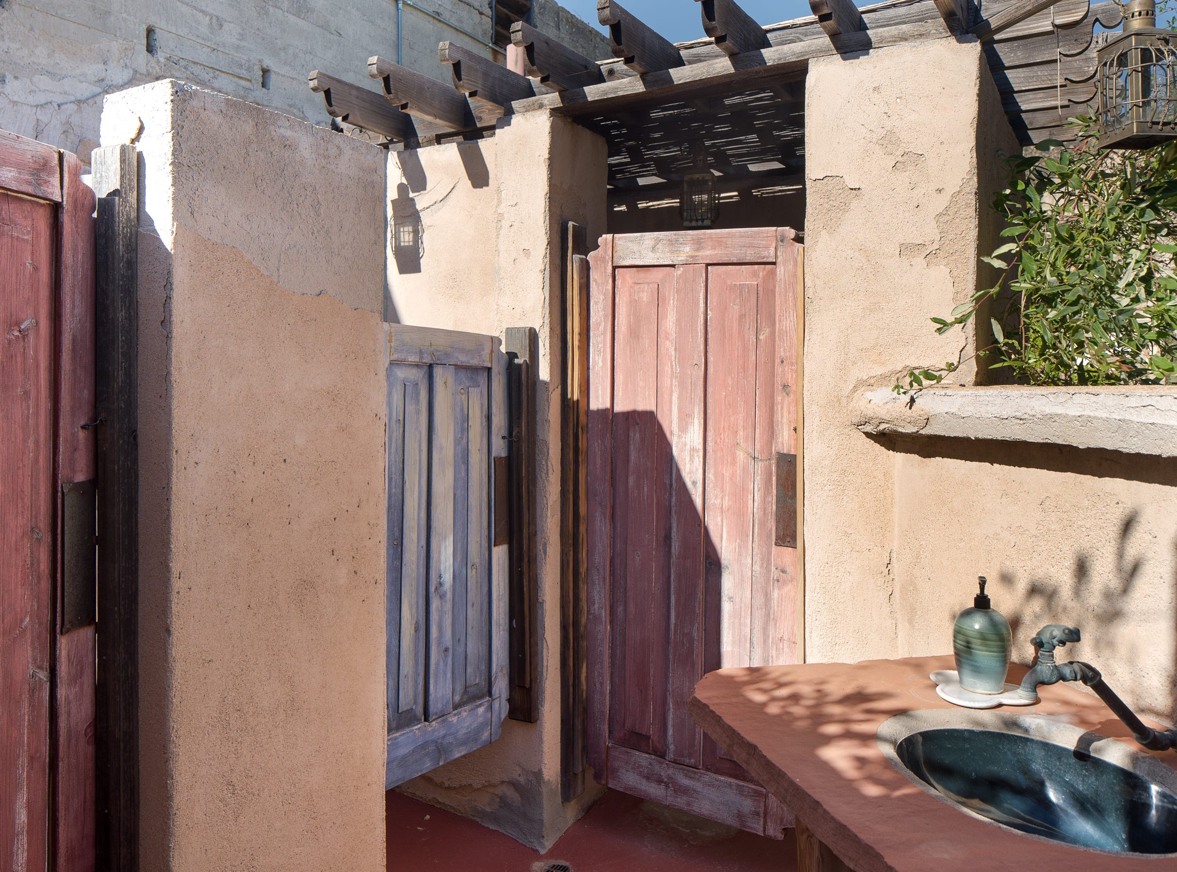 An open-air rooftop bathroom is seen at the 100-year-old former Little Daisy Hotel in Jerome, which was later turned into a single-family home and is now on the market.