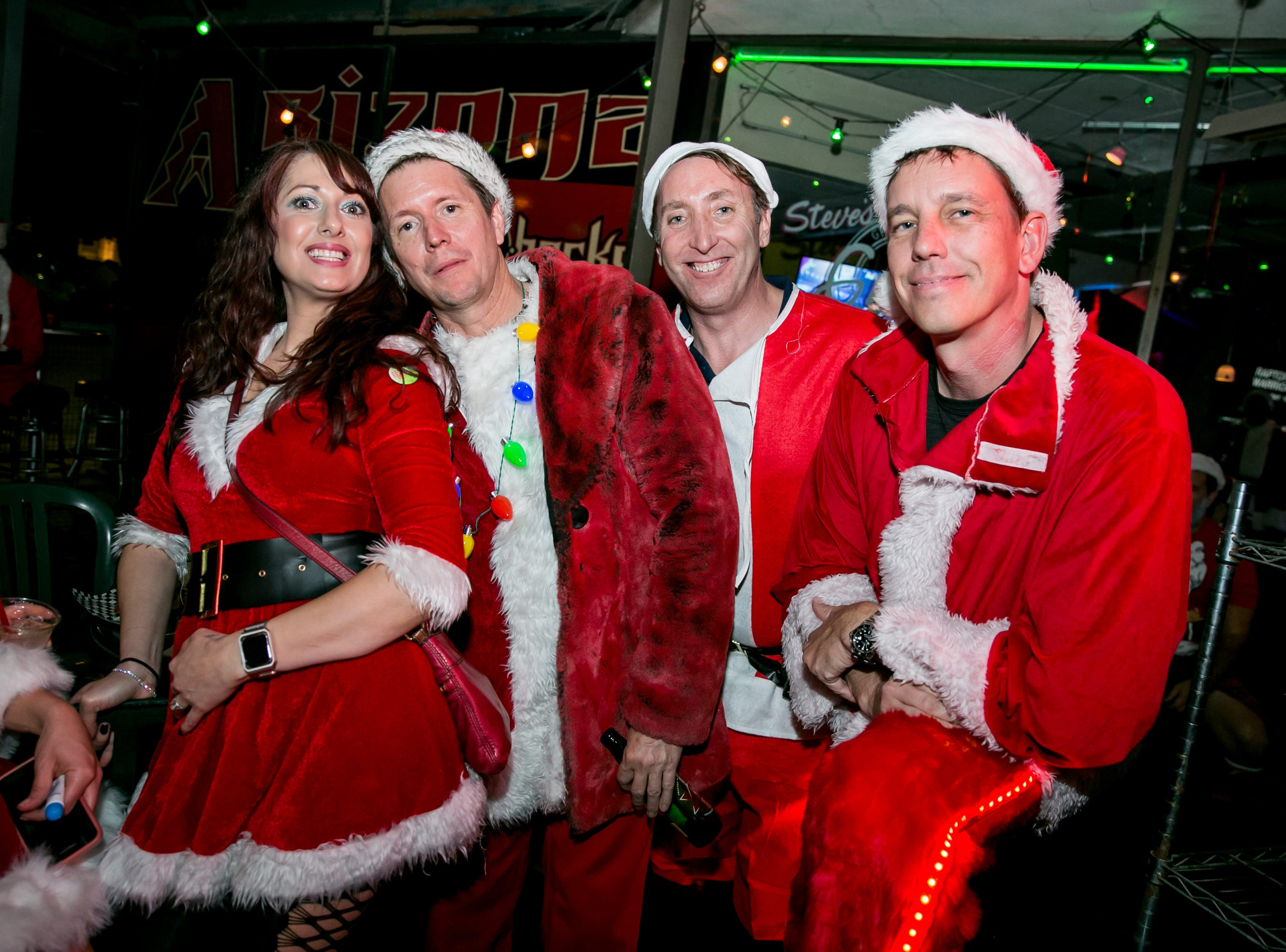 Santas came out in droves to Steve's Greenhouse Grill during Santarchy on Saturday, December 8, 2018.