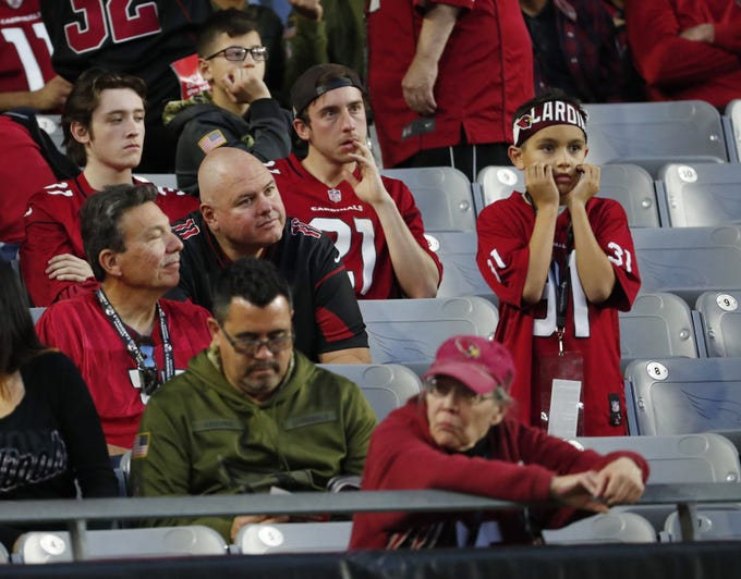 Arizona Cardinals fans watch during the second half against the Detroit Lions in Glendale, Ariz. December 9. Arizona Cardinals lost 17-3.