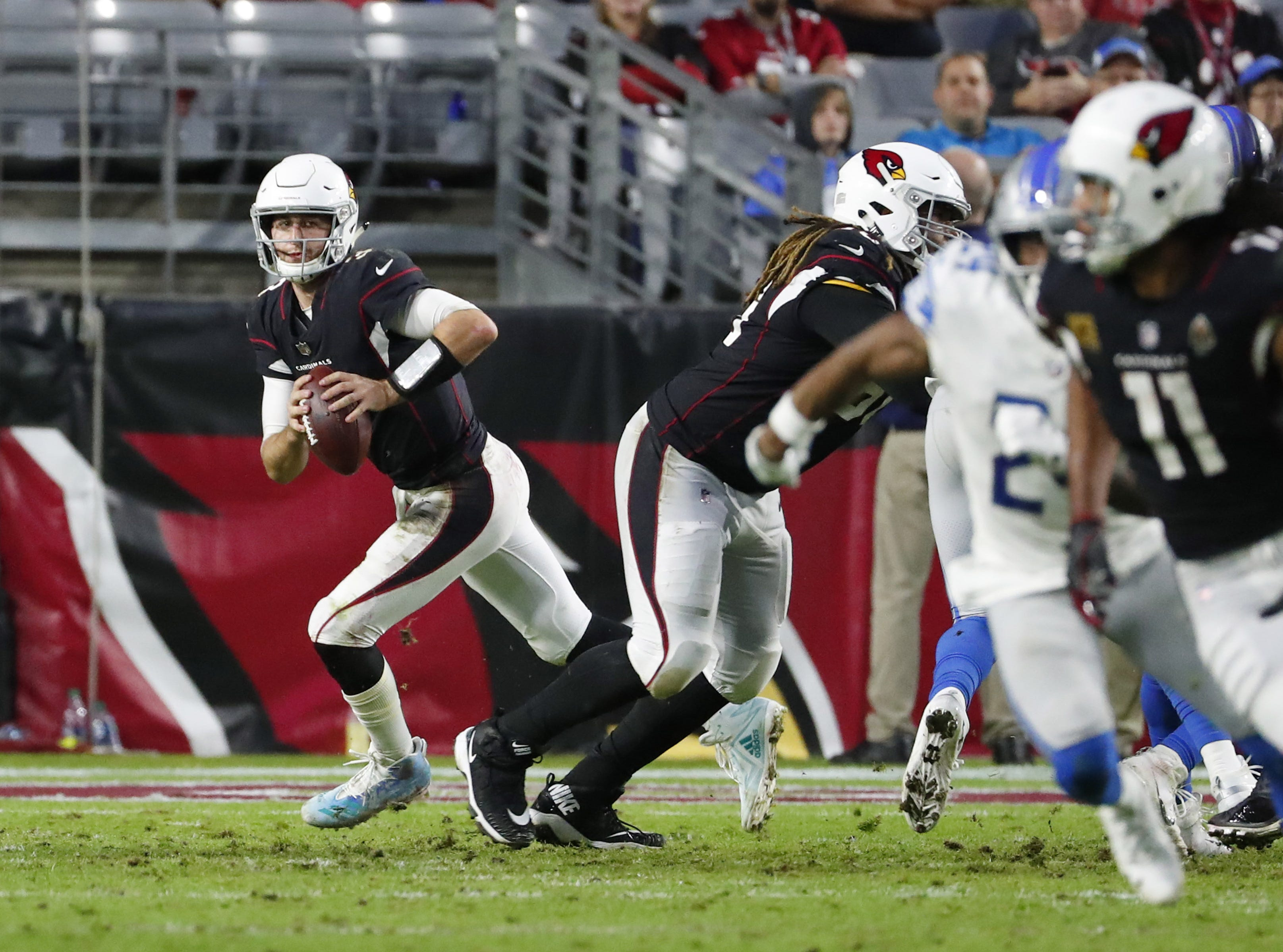 Arizona Cardinals quarterback Josh Rosen (3) scrambles away from pressure against the Detroit Lions during the second half in Glendale, Ariz. December 9.