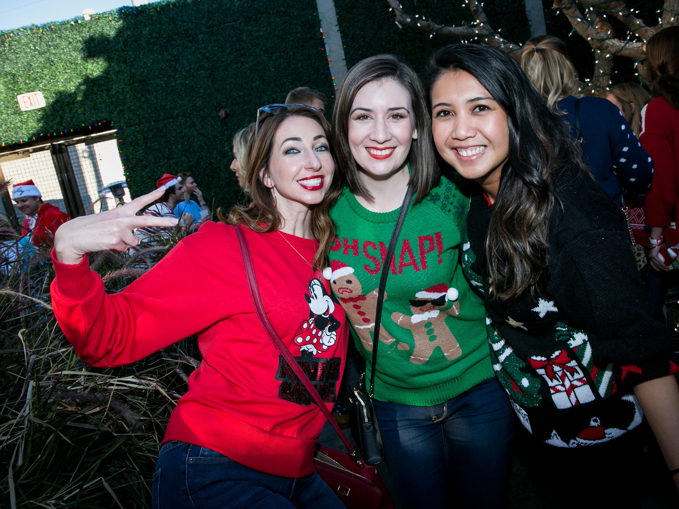 Her gingerbread man sweater was perfect during the Scottsdale Santa Crawl at Wasted Grain on Saturday, December 8, 2018.