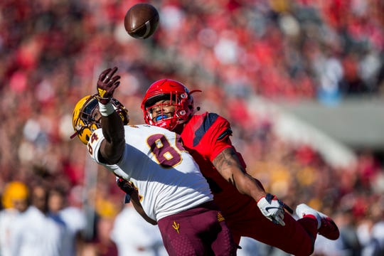 Arizona's Troy Young is flagged for pass interference against Arizona State's Frank Darby during the first half of the Territorial Cup on  Nov. 24, 2018, at Arizona Stadium in Tucson.