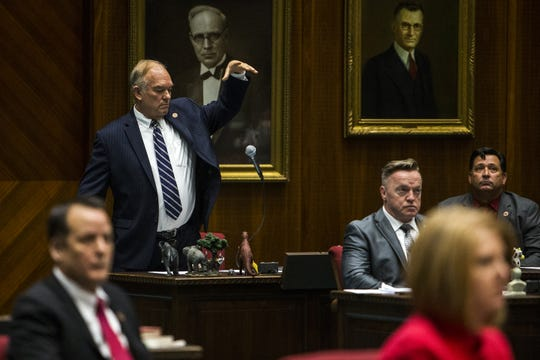 Rep. Don Shooter drops his microphone after giving a statement Feb. 1, 2018, during a vote on whether to remove him from office. The House voted 56-3 to expel Shooter.