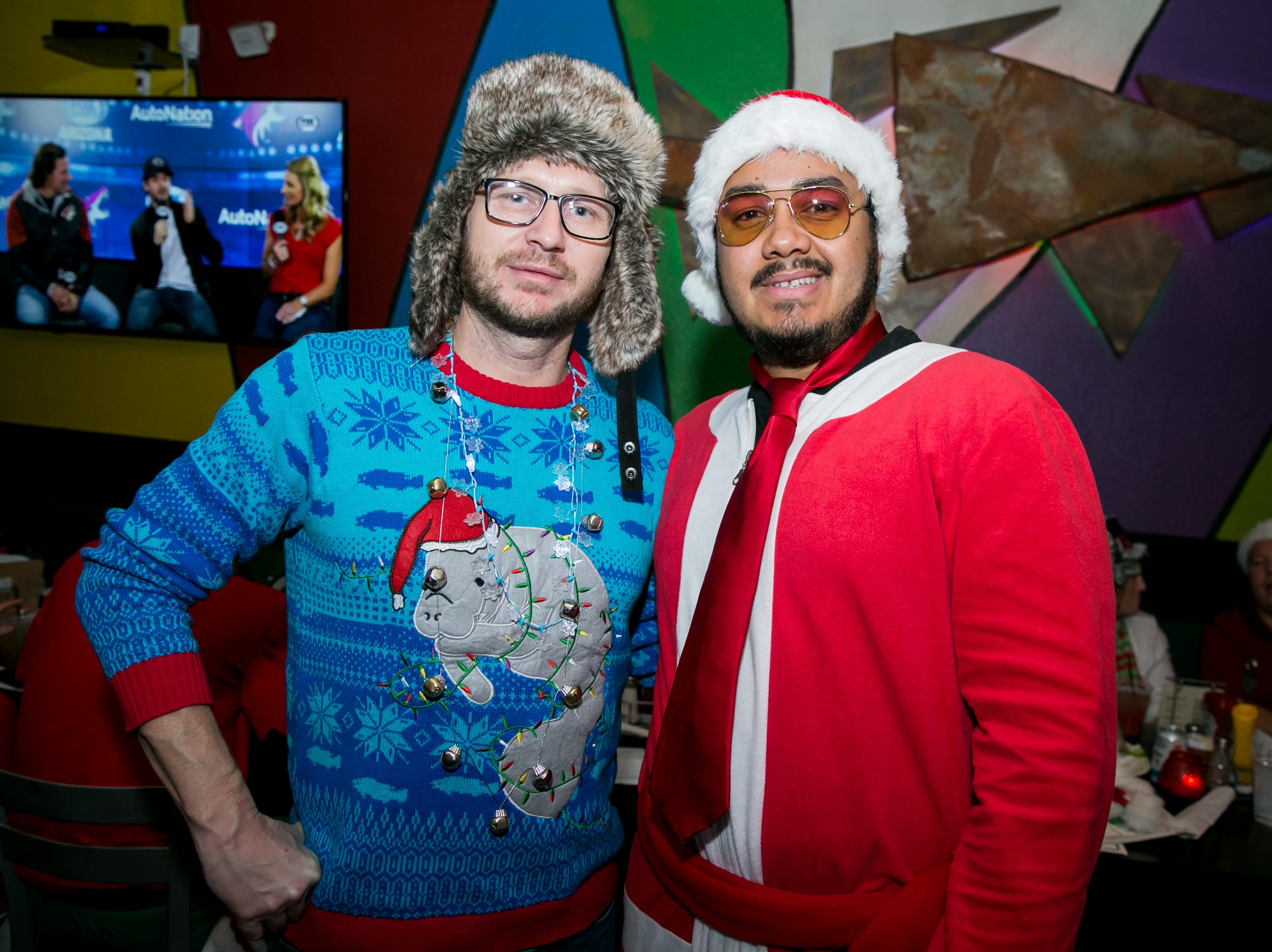 His manatee sweater was amazing at Steve's Greenhouse Grill during Santarchy on Saturday, December 8, 2018.