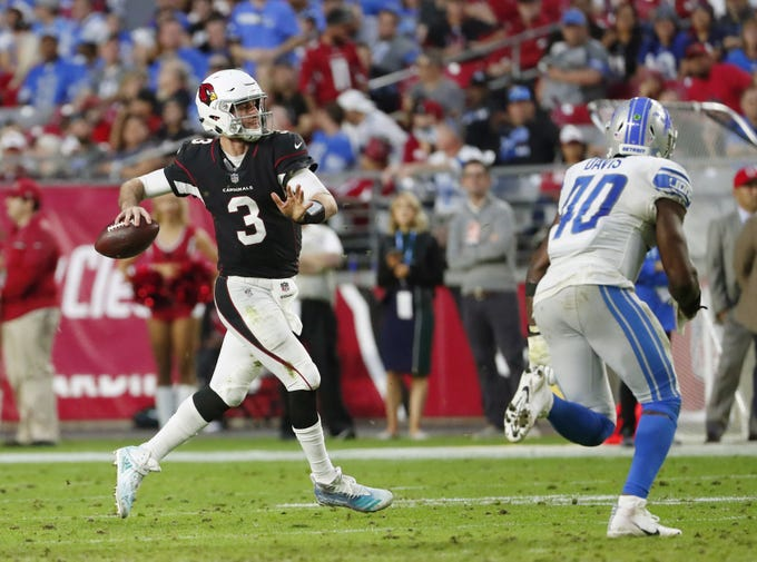 Arizona Cardinals quarterback Josh Rosen (3) throws while pursued by Detroit Lions middle linebacker Jarrad Davis (40) during the second half in Glendale, Ariz. December 9.
