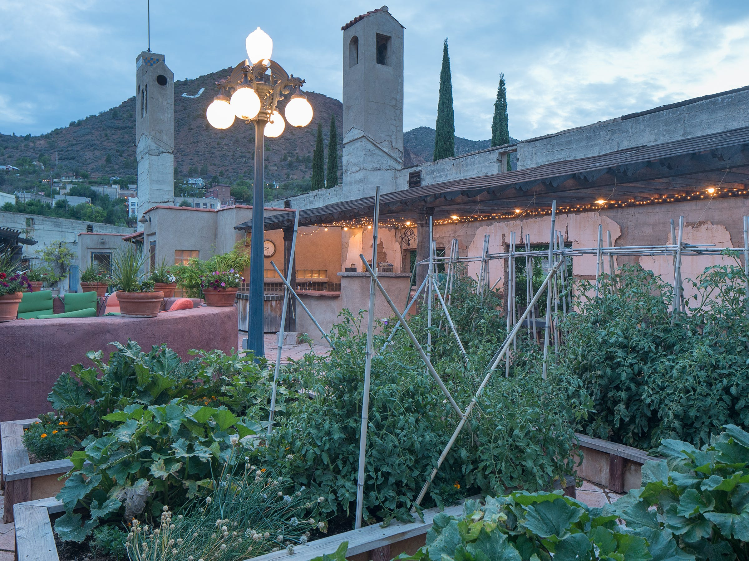 A rooftop garden is seen at dusk at the the 100-year-old former Little Daisy Hotel in Jerome, which was later turned into a single-family home and is now on the market.