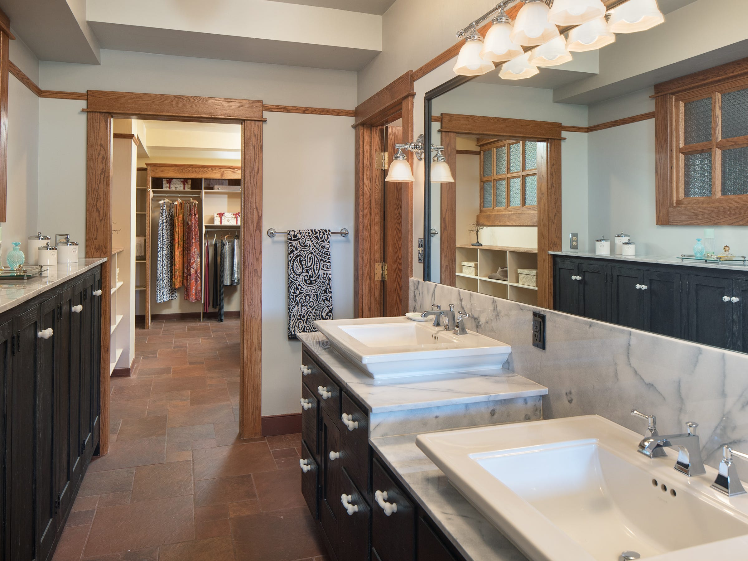 Sinks in a master bathoroom are seen at the 100-year-old former Little Daisy Hotel in Jerome, which was later turned into a single-family home and is now on the market.