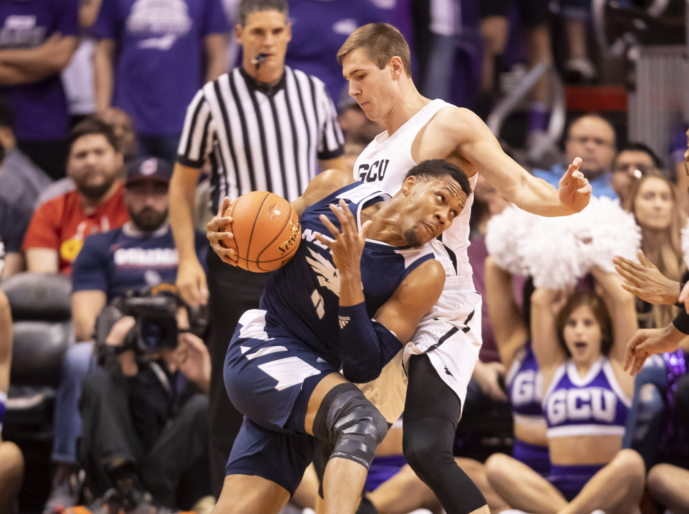 Forward Tre'Shawn Thurman (0) of Nevada Wolf Pack drives to the basket against guard Gerard Martin (42) of the Grand Canyon Antelopes during the 2018 Jerry Colangelo Classic at Talking Stick Resort Arena on Sunday, December 9, 2018 in Phoenix, Arizona.